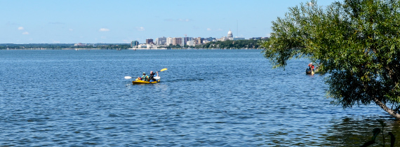 City of Madison skyline with kayaks on the lake